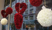 Dating Upside Down - Post - VDay Wrap Up - Feature Image - Retail Window flower hearts and balls